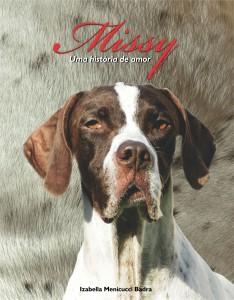 Capa do livro mostra a cachorra branca e marrom, Missy.