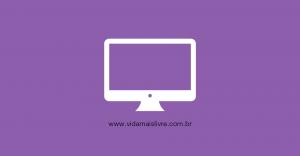 Em fundo roxo, ícone branco que representa um monitor de computador