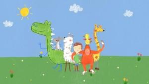"""Cena do programa """"Pablo"""", animação com traços infantis e assimétricos em tons pasteis. Em um gramado, um garoto com cabelos castanhos está rodeado por um dinossauro, um pássaro, um rato, uma girafa, um macaco e uma ovelha"""