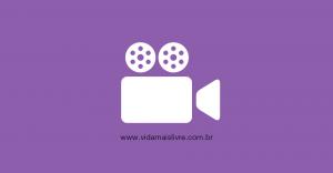 Em fundo roxo, ícone que representa uma filmadora em branco