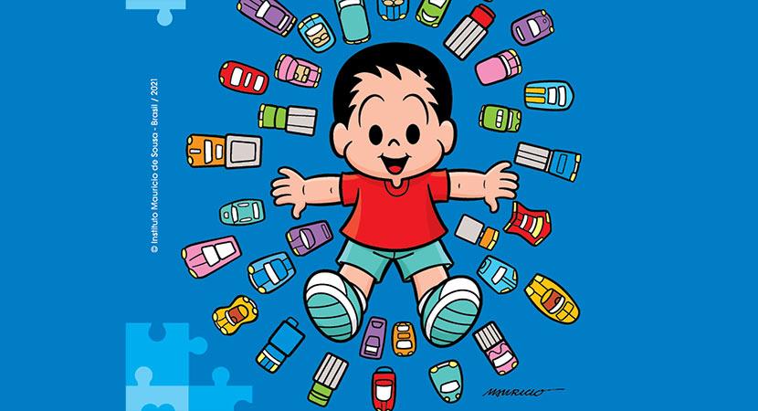 Arte com fundo azul e ilustração do personagem André, que é autista, com diversos brinquedos ao seu redor, como carrinhos, caminhões e barcos. Há o texto Instituto Mauricio de Sousa - Brasil/2021